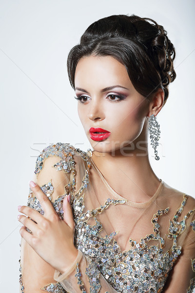 Elegance. Luxurious Good Looking Woman in Dress with Sequins and Jewels Stock photo © gromovataya
