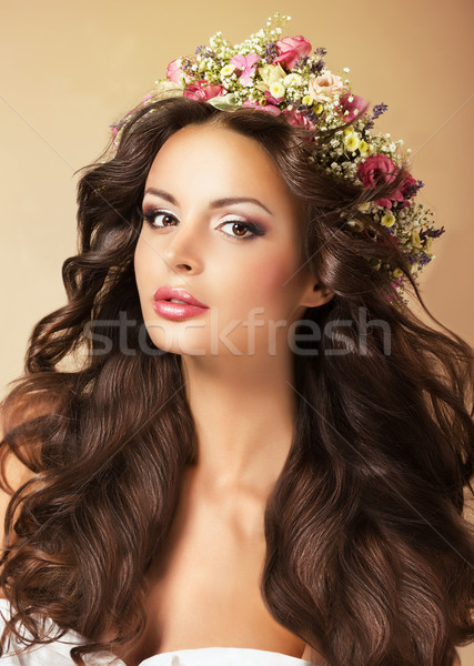 Classy Fashion Model with Perfect Flossy Brown Hair and Wreath of Flowers Stock photo © gromovataya