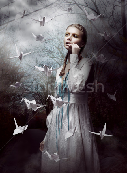 Night. Woman in  Mysterious Forest launching handmade paper Cranes. Origami Stock photo © gromovataya