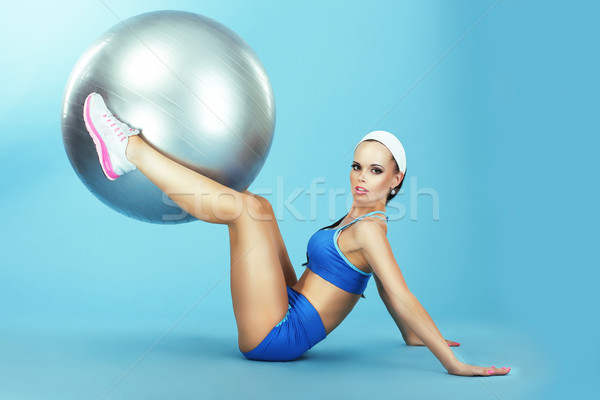 Training. Athletics. Woman in Sportswear with Fitness Ball Stock photo © gromovataya
