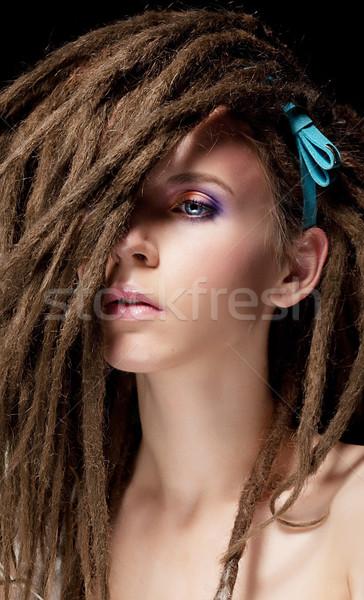 Dreadlocks. Fashion hairstyle with dreads - beauty woman face Stock photo © gromovataya