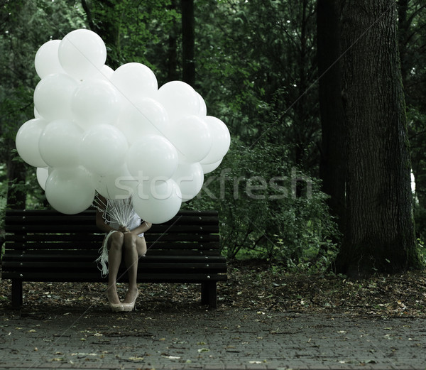 Sentimentality. Nostalgia. Lonely Woman with Air Balloons sitting on Bench in the Park Stock photo © gromovataya