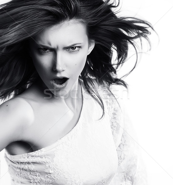 Yelling young female with waving long hair - series of photos Stock photo © gromovataya