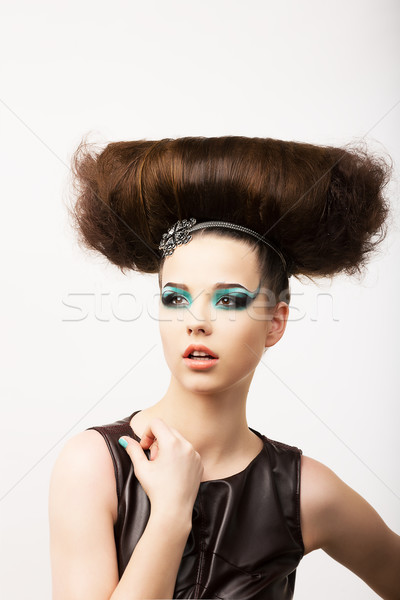 Glamour. Vitality. Portrait of Unusual Brunette with Extraordinary Festive Hairdo Stock photo © gromovataya