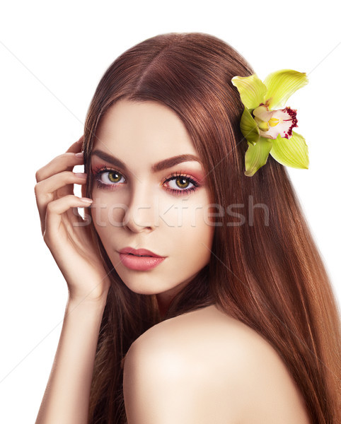 Pampering. Serene Woman with Orchid Fresh Flower in Hair. Tenderness Stock photo © gromovataya