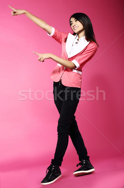 Adolescence. Young Funny Asian Woman Gesturing with her Hands Stock photo © gromovataya