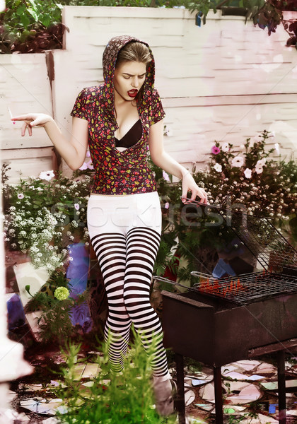 Joke. Eccentric Crazy and Funny Woman Hipster cooks Barbecue on Bbq Grill Stock photo © gromovataya