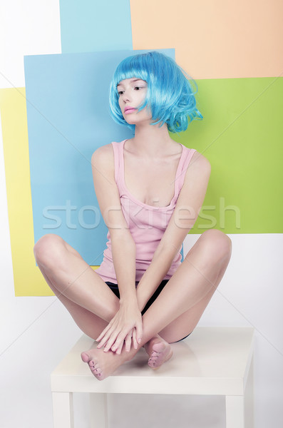 Patchwork. Funky Girl in Azure Wig Sitting in Studio on White Chair Stock photo © gromovataya