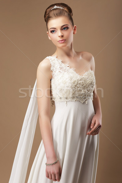 Femininity. Gentle Woman in Lacy Dress over Beige Background Stock photo © gromovataya