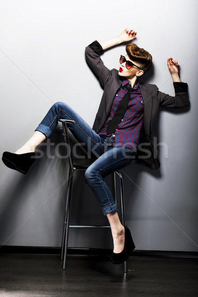Pin-up girl in sunglasses sitting. American retro style Stock photo © gromovataya