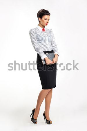 Thoughtful business lady in fashion skirt and blouse with book Stock photo © gromovataya
