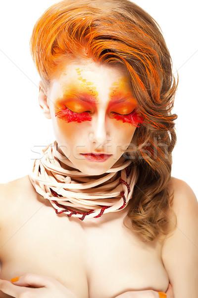 Ardente estilizado mulher vermelho falso Foto stock © gromovataya