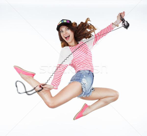 Lifestyle. Dynamic Animated Funny Woman Jumping. Freedom Stock photo © gromovataya