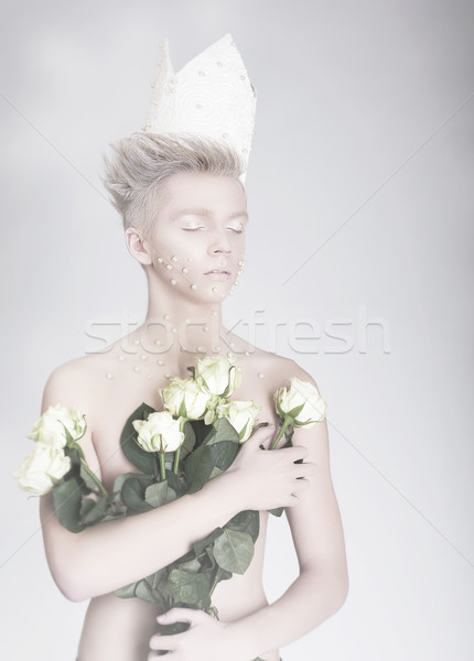 Artistry. Trendy Young Man in Paper Crown with Flowers Stock photo © gromovataya