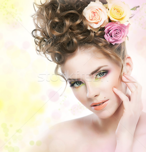 Lovely young girl with flowers touching her beautiful face Stock photo © gromovataya