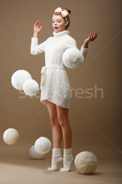 Falling Skeins. Surprised Woman in Woolen Knitted Jersey with White Balls of Yarn Stock photo © gromovataya