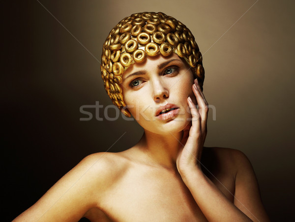 Creativity. Surreal Portrait of Stylized Woman with Golden Headwear as a Helmet Stock photo © gromovataya