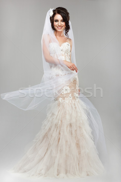 Expression. Positive Emotions. Gorgeous Smiling Bride in Windy Wedding Dress Stock photo © gromovataya