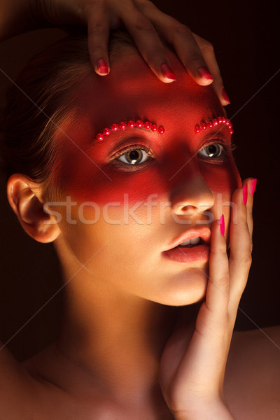 Fashion Art Concept. Beauty Woman Face with Red Painted Mask Stock photo © gromovataya