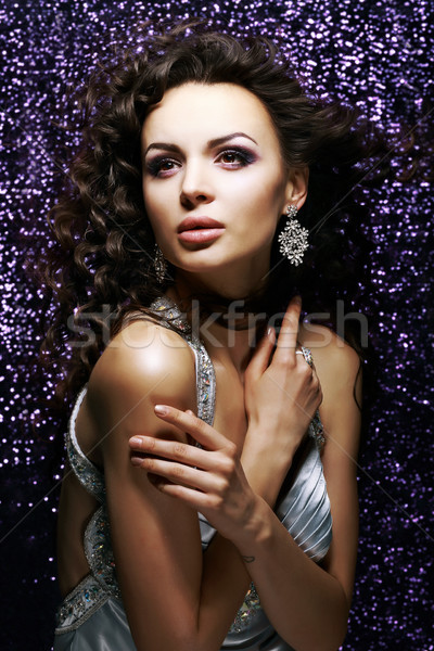 Elegance. Exquisite Sultry Lady with Waved Hair. Brilliance Stock photo © gromovataya