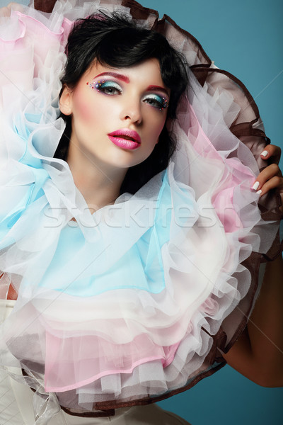 Fantasy. Young Woman with Colorful Frilled Satiny Collar Stock photo © gromovataya