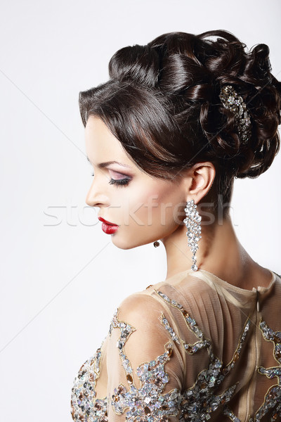 Profile of Classy Brown Hair Lady with Jewelry and Festive Hairstyle Stock photo © gromovataya