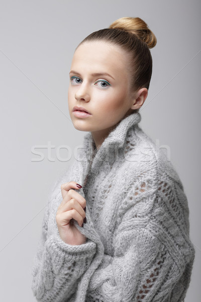 Portrait of Young Pretty Woman in Knitted Woolen Gray Jersey Stock photo © gromovataya