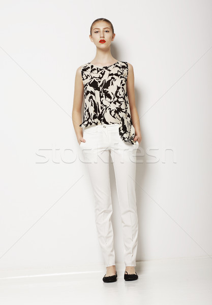 Stylish Young Woman Mod in Light Clothes over White Background. Fashion Style Stock photo © gromovataya