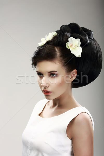 Face of Beautiful Brunette Bride Fashion Model. Elegant Hairdo with Vernal Flowers Stock photo © gromovataya