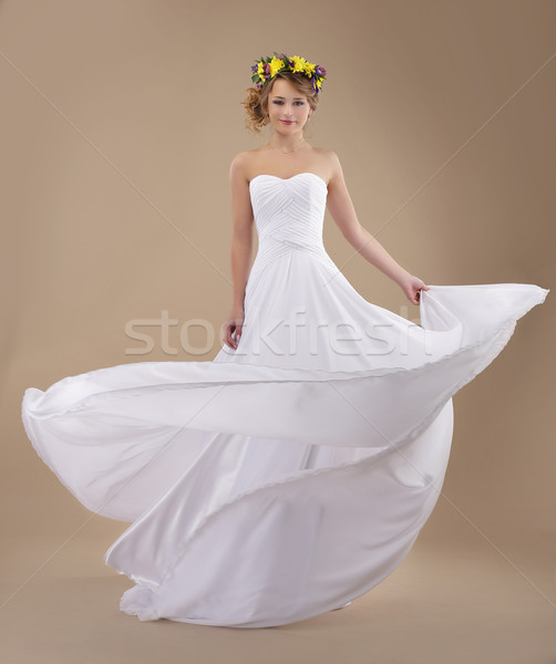 Motion. Woman with Wreath of Flowers and Fluttering Light Dress Stock photo © gromovataya