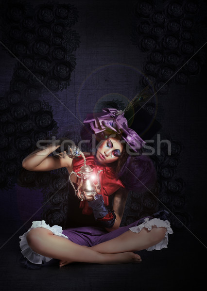 Witchcraft. Fairytale. Enigmatic Magus with Lamp in Darkness Stock photo © gromovataya