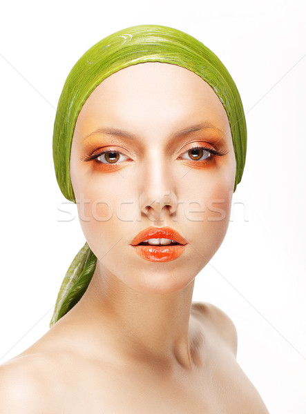 Art. Glamorous Woman in Green Headwear and Trendy Professional Make-up Stock photo © gromovataya