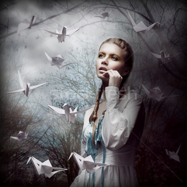 Inspiration. Woman with Flying White Origami Swans in Dark Mystic Forest Stock photo © gromovataya