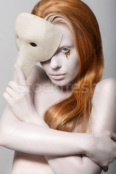 Stylized Woman with Carnival Venetian Mask. Masquerade. Platinum Makeup with Golden Teardrops Stock photo © gromovataya