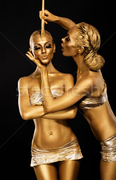 Stock photo: Fantasy. Creativity. Shiny Women's Gold Gilded Bodies. Arts