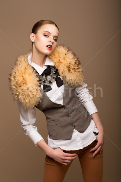 Portrait of Perfect Arrogant Woman in Grey Waistcoat and Fur Collar Stock photo © gromovataya