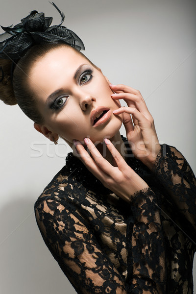 Expressive Woman in Black Dress touching her Emotional Face. Surprise Stock photo © gromovataya