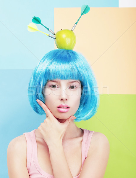 Creativity. Woman with Painted Blue Hairs and Apple on her Head Stock photo © gromovataya