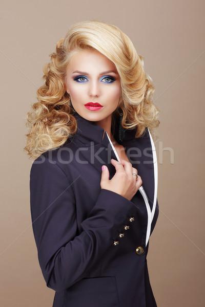 Kobieta niebieski garnitur model włosy Zdjęcia stock © gromovataya