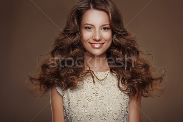Beautiful Happy Brunette with Long Curly Hairs Stock photo © gromovataya