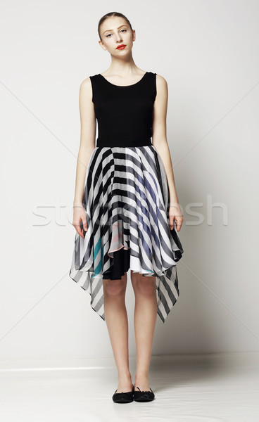 Full Length of Modish Woman in Strippy Dress. Springtime Workday Collection Stock photo © gromovataya