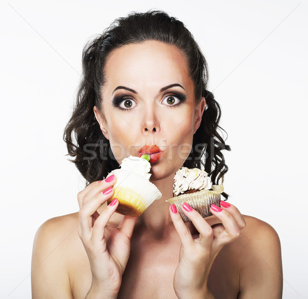 Gluttony. Hungry Funny Young Woman Greedily Eats Cakes with Cream Stock photo © gromovataya