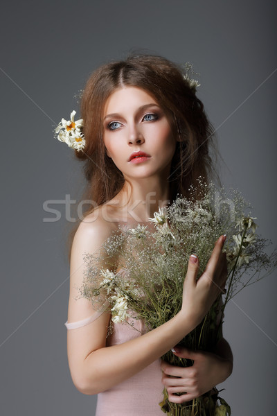 Sentimentality. Redhaired Affectionate Muse with Flowers in Dreams Stock photo © gromovataya