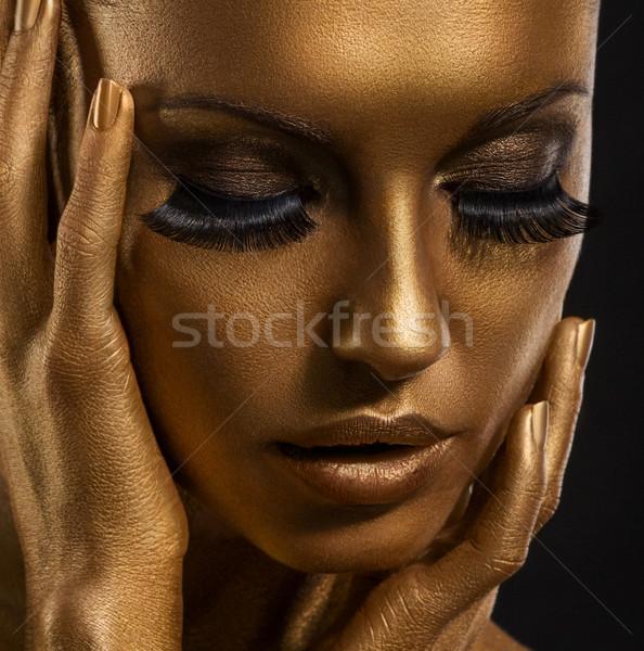 Gilt. Golden Woman's Face Closeup. Futuristic Gilded Make-up. Painted Skin Stock photo © gromovataya