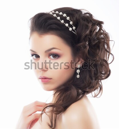 Stock photo: Wedding style - gentle young fiancee. Coiffure and makeup