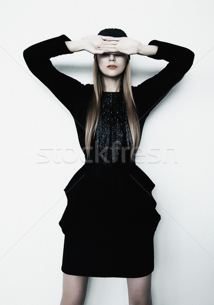 Fashion model blond girl in contemporary black dress posing Stock photo © gromovataya