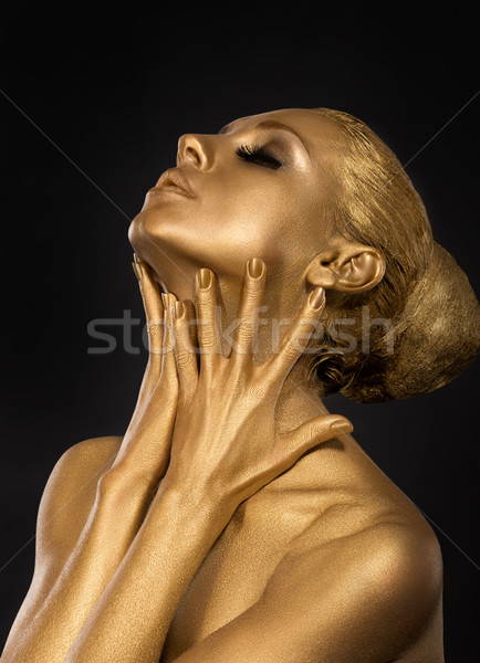 Coloring. Gilt. Golden Plated Woman's Face. Art concept. Gilded Body. Focus on her hands Stock photo © gromovataya