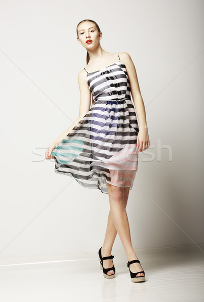 Lifestyle. Attractive Slim Female wearing Sleeveless Tabby Dress. Sensuality Stock photo © gromovataya