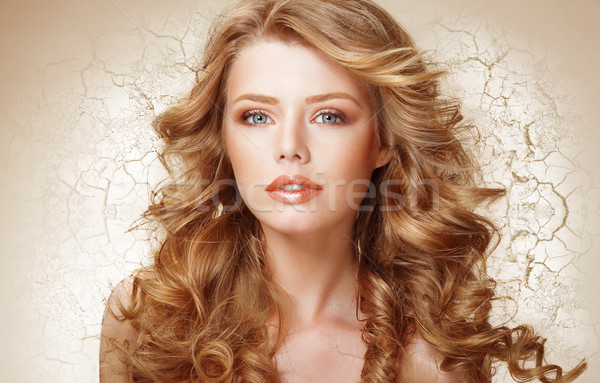 Recovery Concept. Woman with Curly Hair over Cracked Dried Wall (Earth) Stock photo © gromovataya