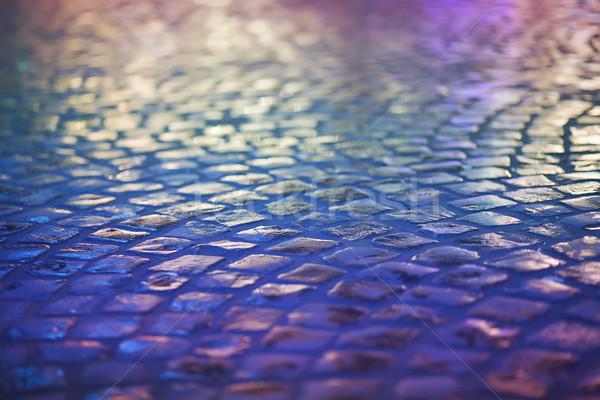 Cobble Stone Pavement - Reflexion in Urban Night. Wet Blue Sidewalk Stock photo © gromovataya